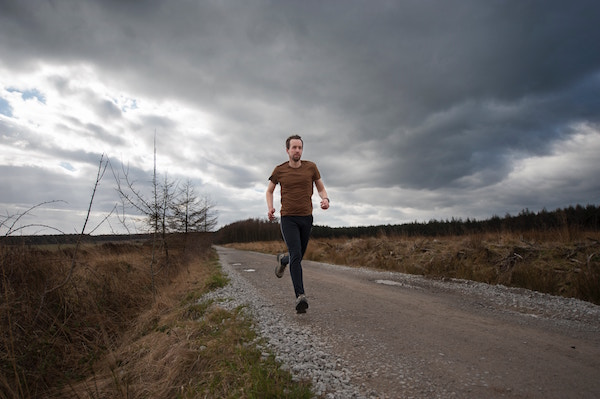 Man Jogging Down The Road