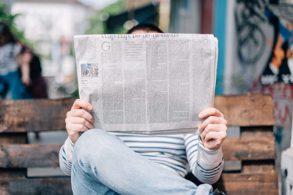 The Anxious Truth Newsletter - Man Reading Newspaper